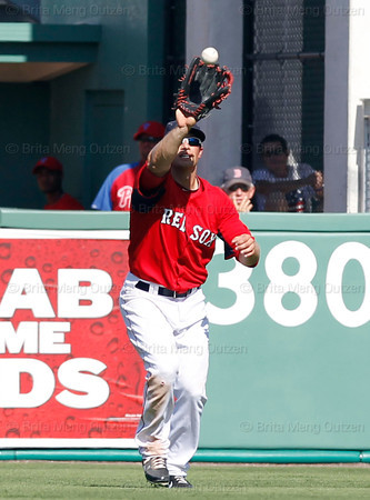 FORT MYERS, FL, March 24, 2012: Boston Red Sox right fielder Daniel Nava catches a fly ball hit by Philadelphia Phillies batter Edgar Duran in the ninth inning of a Grapefruit League spring training game at JetBlue Park at Fenway South. (Brita Meng Outzen/Boston Red Sox)