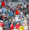 FORT MYERS, FL, March 24, 2012: A fan reaches for a foul ball while holding dollar bills in the same hand during the fourth inning of   Boston Red Sox play the Philadelphia Phillies in a Grapefruit League spring training game at JetBlue Park at Fenway South. (Brita Meng Outzen/Boston Red Sox)