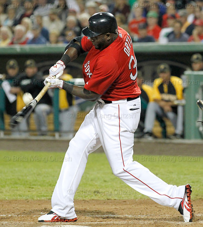 FORT MYERS, FL, March 9, 2012: Boston Red Sox batter David Ortiz makes contact with a baseball thrown by Pittsburgh Pirates pitcher Ryota Igarashi in the sixth inning of a Grapefruit League spring training game at JetBlue Park at Fenway South. (Brita Meng Outzen/Boston Red Sox)