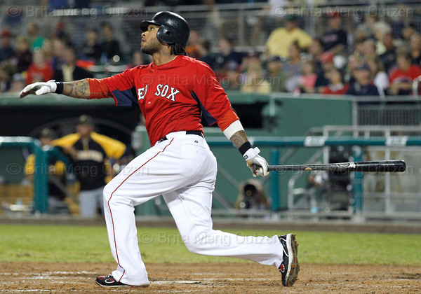 FORT MYERS, FL, March 9, 2012: Boston Red Sox batter Darnell McDonald watches his solo home run off Pittsburgh Pirates pitcher Doug Slaten in the seventh inning of a Grapefruit League spring training game at JetBlue Park at Fenway South. (Brita Meng Outzen/Boston Red Sox)
