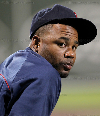 FORT MYERS, FL, March 9, 2012: Boston Red Sox left fielder Carl Crawford watches the action on the field from the dugout during the Grapefruit League spring training game between the Red Sox and Pittsburgh Pirates at JetBlue Park at Fenway South. (Brita Meng Outzen/Boston Red Sox)