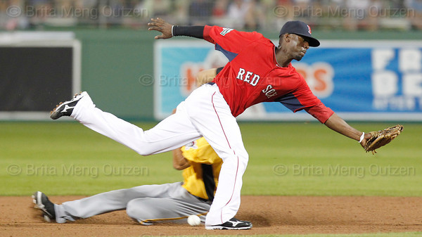 FORT MYERS, FL, March 9, 2012: Boston Red Sox second baseman Pedro Ciriaco can't handle the throw as Pittsburgh Pirates base runner  Gorkys Hernandez steals second base in the seventh inning of a Grapefruit League spring training game at JetBlue Park at Fenway South. (Brita Meng Outzen/Boston Red Sox)