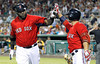 FORT MYERS, FL, March 9, 2012: Boston Red Sox designated hitter David Ortiz, left, is congratulated by teammate Cody Ross after hitting a solo home run off Pittsburgh Pirates pitcher Tony Watson in the fourth inning of a Grapefruit League spring training game at JetBlue Park at Fenway South. (Brita Meng Outzen/Boston Red Sox)