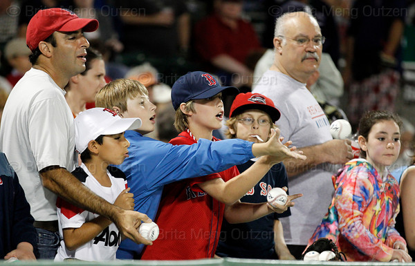 FORT MYERS, FL, March 9, 2012: Fans look for autographs from Boston Red Sox players before the Grapefruit League spring training game against the Pittsburgh Pirates at JetBlue Park at Fenway South. (Brita Meng Outzen/Boston Red Sox)