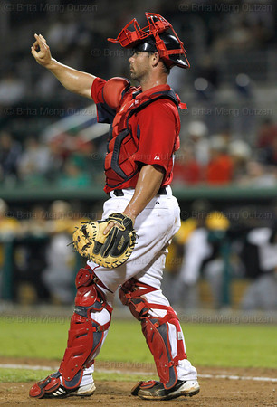 FORT MYERS, FL, March 9, 2012: Boston Red Sox catcher Daniel Butler signals the infield between pitches during the ninth inning of a Grapefruit League spring training game against the Pittsburgh Pirates at JetBlue Park at Fenway South. (Brita Meng Outzen/Boston Red Sox)