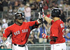 FORT MYERS, FL, March 9, 2012: Boston Red Sox batter Darnell McDonald, left, is congratulated by teammate Mike Aviles after hitting a  solo home run off Pittsburgh Pirates pitcher Doug Slaten in the seventh inning of a Grapefruit League spring training game at JetBlue Park at Fenway South. (Brita Meng Outzen/Boston Red Sox)