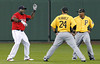 FORT MYERS, FL, March 9, 2012: Boston Red Sox designated hitter David Ortiz, left, has an animated conversation with Pittsburgh Pirates third baseman Pedro Alvarez, center, and infielder Anderson Hernandez during warmups before their Grapefruit League spring training game at JetBlue Park at Fenway South. (Brita Meng Outzen/Boston Red Sox)