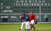 FORT MYERS, FL, March 9, 2012: From left, Boston Red Sox pitcher Clay Buchholz, pitching coach Bob McClure and catcher Kelly Shoppach walk from the bullpen to the dugout in front of the Green Monster scoreboard at JetBlue Park at Fenway South prior to the Grapefruit League spring training game against the Pittsburgh Pirates. (Brita Meng Outzen/Boston Red Sox)