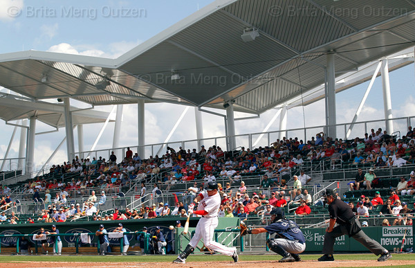 FORT MYERS, FL, March 27, 2012: Boston Red Sox batter Ryan Sweeney swings at a pitch from Tampa Bay Rays pitcher Brandon Gomes in the seventh inning of a Grapefruit League spring training game at JetBlue Park at Fenway South. (Brita Meng Outzen/Boston Red Sox)