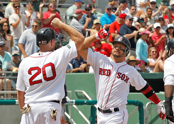 FORT MYERS, FL, March 27, 2012: Boston Red Sox batter Cody Ross, right, is congratulated by teammate Kevin Youkilis after hitting a three-run home run off Tampa Bay Rays pitcher Joel Peralta in the second inning of a Grapefruit League spring training game at JetBlue Park at Fenway South. (Brita Meng Outzen/Boston Red Sox)