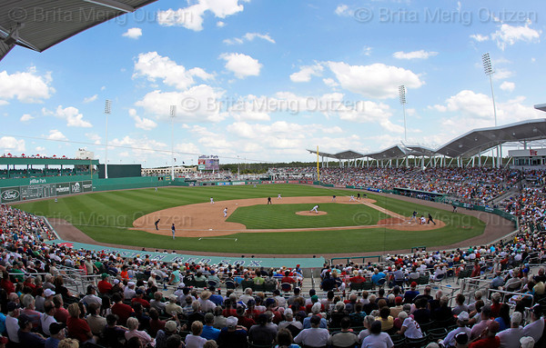 FORT MYERS, FL, March 27, 2012: Boston Red Sox pitcher Scott Atchinson throws a pitch to a Tampa Bay Rays batter in the sixth inning of a Grapefruit League spring training game at JetBlue Park at Fenway South. (Brita Meng Outzen/Boston Red Sox)