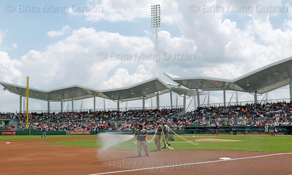 FORT MYERS, FL, March 27, 2012: The grounds crew waters down the base paths before the Grapefruit League spring training game between the Boston Red Sox and Tampa Bay Rays at JetBlue Park at Fenway South. (Brita Meng Outzen/Boston Red Sox)