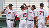 FORT MYERS, FL, March 27, 2012: From left, Boston Red Sox players Ryan Sweeney, Dustin Pedroia, Cody Ross and Nate Spears celebrate following Boston's victory over the Tampa Bay Rays in a Grapefruit League spring training game at JetBlue Park at Fenway South. (Brita Meng Outzen/Boston Red Sox)