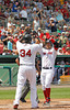 FORT MYERS, FL, March 27, 2012: Boston Red Sox batter Cody Ross, right, is congratulated by teammate David Ortiz after hitting a three-run home run off Tampa Bay Rays pitcher Joel Peralta in the second inning of a Grapefruit League spring training game at JetBlue Park at Fenway South. (Brita Meng Outzen/Boston Red Sox)