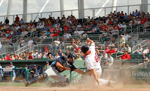 FORT MYERS, FL, March 27, 2012: Boston Red Sox base runner Ryan Lavarnway, right, is out at home after being tagged by Tampa Bay Rays catcher Keith Castillo in the eighth inning of a Grapefruit League spring training game at JetBlue Park at Fenway South. (Brita Meng Outzen/Boston Red Sox)