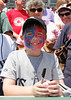 FORT MYERS, FL, March 27, 2012: A young fan looks for autographs before from Boston Red Sox players before their game against the Tampa Bay Rays in a Grapefruit League spring training game at JetBlue Park at Fenway South. (Brita Meng Outzen/Boston Red Sox)