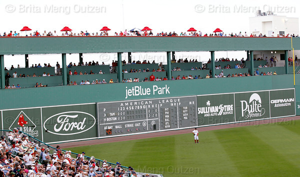 FORT MYERS, FL, March 27, 2012: Boston Red Sox left fielder Cody Ross waits in front of the Green Monster left field wall for Red Sox pitcher Josh Beckett to throw the baseball to a Tampa Bay Rays batter  in the fourth inning of a Grapefruit League spring training game at JetBlue Park at Fenway South. (Brita Meng Outzen/Boston Red Sox)