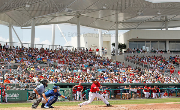 FORT MYERS, FL, March 29, 2012:  Boston Red Sox batter Dustin Pedroia hits a baseball thrown by Toronto Blue Jays pitcher Luis Perez in the fifth inning of a Grapefruit League spring training game at JetBlue Park at Fenway South. (Brita Meng Outzen/Boston Red Sox)