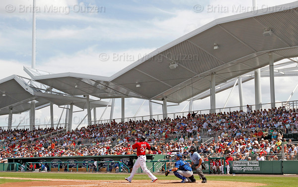 FORT MYERS, FL, March 29, 2012:  Boston Red Sox designated hitter David Ortiz hits a solo home run off Toronto Blue Jays pitcher Luis Perez in the sixth inning of a Grapefruit League spring training game at JetBlue Park at Fenway South. (Brita Meng Outzen/Boston Red Sox)