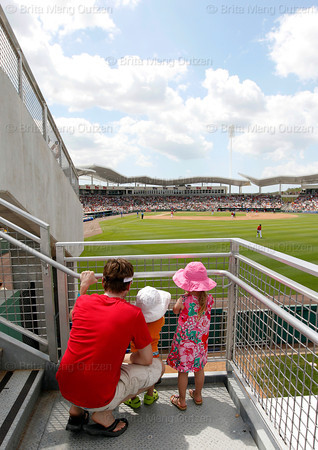 FORT MYERS, FL, March 29, 2012: A father and his two young children pause on the steps leading to the right field grandstand seats for a view of the diamond The Boston Red Sox play the Toronto Blue Jays in a Grapefruit League spring training game at JetBlue Park at Fenway South. (Brita Meng Outzen/Boston Red Sox)