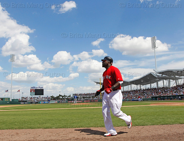 FORT MYERS, FL, March 29, 2012:  Boston Red Sox designated hitter David Ortiz returns to the dugout after hitting a solo home run off Toronto Blue Jays pitcher Luis Perez in the sixth inning of a Grapefruit League spring training game at JetBlue Park at Fenway South. (Brita Meng Outzen/Boston Red Sox)