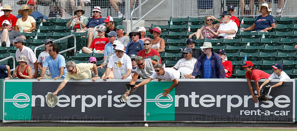 FORT MYERS, FL, March 29, 2012: Boston Red Sox fans reach over the right field wall with hats and baseball gloves trying to field a foul ball in the ninth inning of a Grapefruit League spring training game against the Toronto Blue Jays at JetBlue Park at Fenway South. (Brita Meng Outzen/Boston Red Sox)