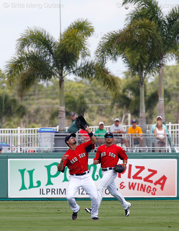 FORT MYERS, FL, March 29, 2012: Boston Red Sox right fielder Shannon Wilkerson, right, watches as center fielder Jason Repko, left, catches a fly ball hit by Toronto Blue Jays Chris Hawkins in the eighth inning of a Grapefruit League spring training game at JetBlue Park at Fenway South. (Brita Meng Outzen/Boston Red Sox)