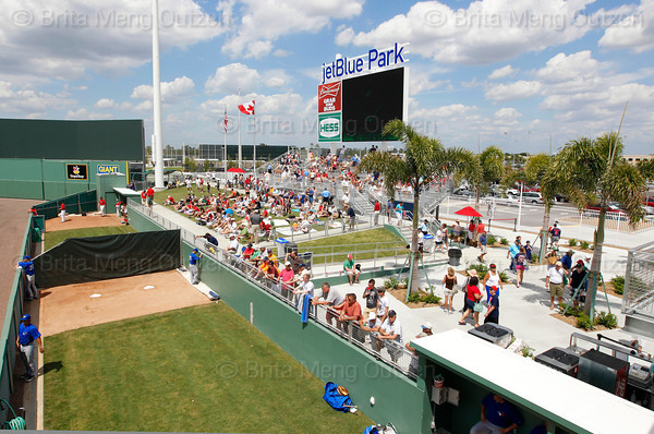 FORT MYERS, FL, March 29, 2012: Fans in the grass seating and bleachers watch the action on the field and in the bullpen as the Boston Red Sox play the Toronto Blue Jays in a Grapefruit League spring training game at JetBlue Park at Fenway South. (Brita Meng Outzen/Boston Red Sox)
