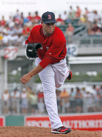 FORT MYERS, FL, March 29, 2012: Boston Red Sox pitcher Justin Thomas follows through on a pitch to a Toronto Blue Jays batter in the seventh inning of a Grapefruit League spring training game at JetBlue Park at Fenway South. (Brita Meng Outzen/Boston Red Sox)