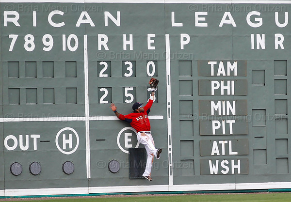 FORT MYERS, FL, March 29, 2012: Boston Red Sox left fielder Darnell McDonald crashes into the Green Monster scoreboard as he jumps to catch a fly ball hit by Toronto Blue Jays batter Luis Valbuena in the seventh inning of a Grapefruit League spring training game at JetBlue Park at Fenway South. (Brita Meng Outzen/Boston Red Sox)