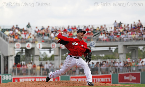 FORT MYERS, FL, March 29, 2012: Boston Red Sox pitcher Alfredo Aceves throws a pitch to a Toronto Blue Jays batter in the sixth inning of a Grapefruit League spring training game at JetBlue Park at Fenway South. (Brita Meng Outzen/Boston Red Sox)