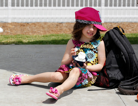 FORT MYERS, FL, March 29, 2012: A young girl cools off with some ice cream during a Grapefruit League spring training game between the Boston Red Sox and Toronto Blue Jays at JetBlue Park at Fenway South. (Brita Meng Outzen/Boston Red Sox)