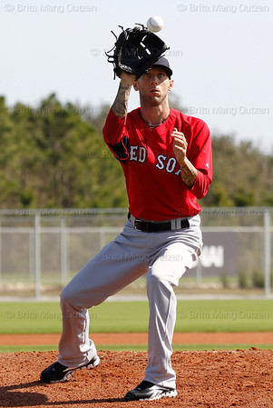 FORT MYERS, FL, Feb. 21, 2012: Boston Red Sox pitcher Jesse Carlson reaches for a batted baseball during pitchers' fielding practice at Spring Training workouts. (Brita Meng Outzen/Boston Red Sox)