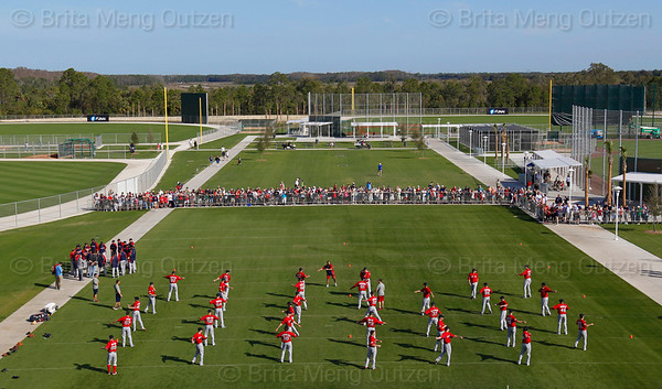 FORT MYERS, FL, Feb. 21, 2012: As fans watch, Boston Red Sox pitchers and catchers warm up at the beginning of their first formal workout of Spring Training on the agility field at Fenway South. (Brita Meng Outzen/Boston Red Sox)