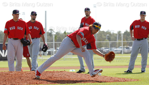 FORT MYERS, FL, Feb. 21, 2012: Boston Red Sox pitcher Daisuke Matsuzaka, center, prepares to field a batted baseball during a pitchers' fielding practice drill as teammates, from left, Alfredo Aceves, Josh Beckett, Andrew Miller and Andrew Bailey watch at Spring Training workouts. (Brita Meng Outzen/Boston Red Sox)