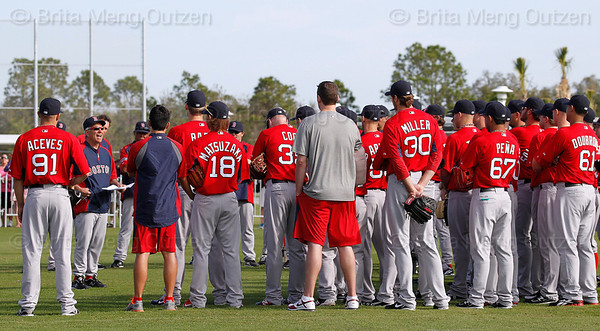 FORT MYERS, FL, Feb. 21, 2012: Boston Red Sox manager Bobby Valentine, second from left, addresses players, staff and coaches before the first formal Red Sox pitchers and catchers workout at Spring Training. (Brita Meng Outzen/Boston Red Sox)