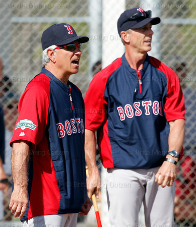 FORT MYERS, FL, Feb. 21, 2012: Boston Red Sox manager Bobby Valentine, left, yells encouragement to pitchers participating in pitchers' fielding practice drills as Red Sox Latin American pitching coordinator Goose Gregson watches at Spring Training workouts. (Brita Meng Outzen/Boston Red Sox)