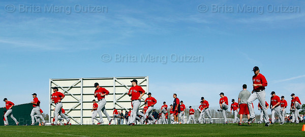 FORT MYERS, FL, Feb. 21, 2012: Boston Red Sox pitchers and catchers warm up at the beginning of their first formal workout of Spring Training. (Brita Meng Outzen/Boston Red Sox)