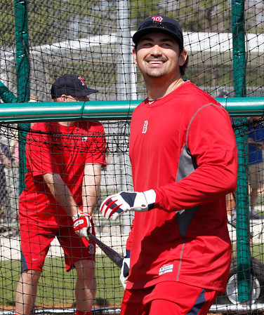 FORT MYERS, FL, Feb. 21, 2012: Boston Red Sox first baseman Adrian Gonzalez, right, smiles after walking out of the batting cage as batter Kevin Youkilis prepares to take batting practice during an informal workout at Spring Training. (Brita Meng Outzen/Boston Red Sox)