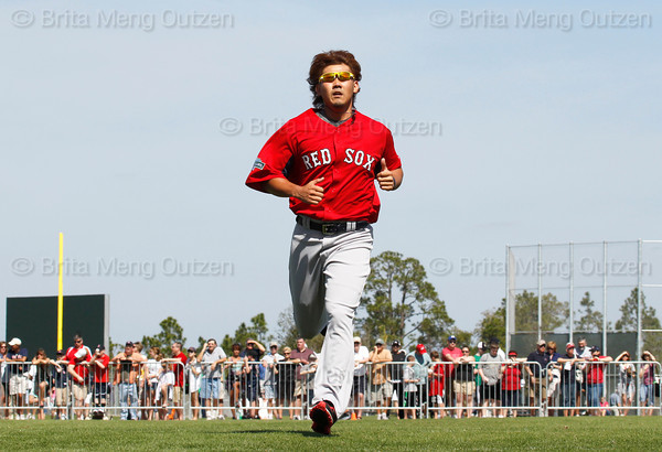 FORT MYERS, FL, Feb. 21, 2012: As fans watch, Boston Red Sox pitcher Daisuke Matsuzaka runs wind sprints to finish his workout at Spring Training. (Brita Meng Outzen/Boston Red Sox)