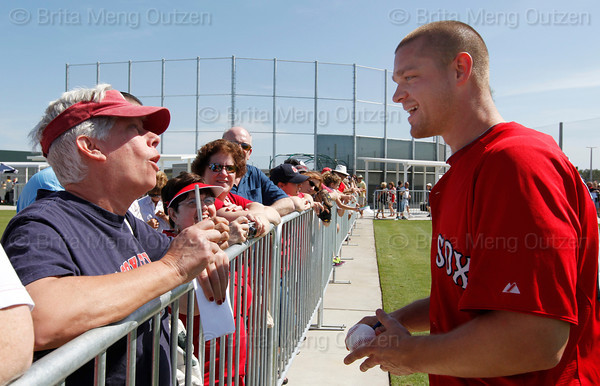 FORT MYERS, FL, Feb. 21, 2012: Boston Red Sox pitcher Michael Bowden, right, talks with a fan while signing autographs following his workout at Spring Training. (Brita Meng Outzen/Boston Red Sox)