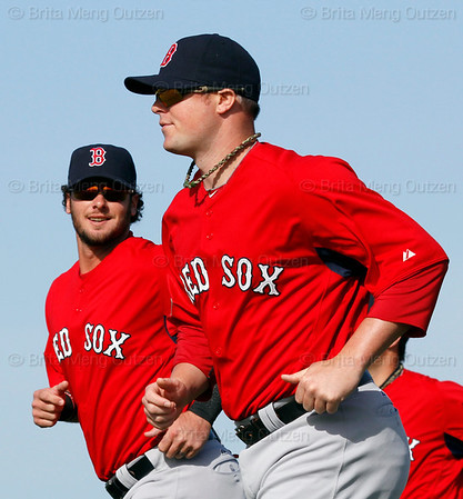 FORT MYERS, FL, Feb. 21, 2012: Boston Red Sox catcher Jarrod Saltalamacchia, left, chats with pitcher Jon Lester during warmups at the first formal pitchers and catchers workout of Spring Training. (Brita Meng Outzen/Boston Red Sox)