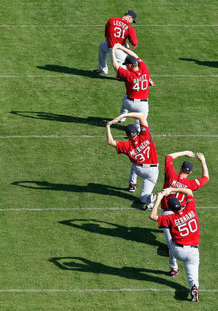 FORT MYERS, FL, Feb. 21, 2012: Boston Red Sox pitchers, from top, Jon Lester, Andrew Bailey, Mark Melancon, Doug Mathis and Justin Germano stretch at the beginning of their first formal workout of Spring Training. (Brita Meng Outzen/Boston Red Sox)