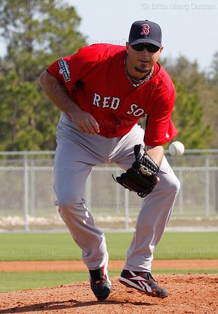 FORT MYERS, FL, Feb. 21, 2012: Boston Red Sox pitcher Josh Beckett fields a baseball during pitchers' fielding practice at Spring Training workouts. (Brita Meng Outzen/Boston Red Sox)