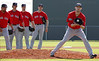 FORT MYERS, FL, Feb. 21, 2012: Boston Red Sox pitcher Daniel Bard, right, fields a ground ball as, from left, Red Sox pitchers Carlos Silva, Clay Buchholz, Matt Albers and Mark Melancon watch during pitchers' fielding practice at Spring Training workouts. (Brita Meng Outzen/Boston Red Sox)