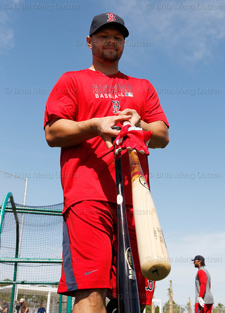FORT MYERS, FL, Feb. 21, 2012: Boston Red Sox outfielder Cody Ross pushes his batting gloves down his bat handle after batting practice during an informal workout at Spring Training. (Brita Meng Outzen/Boston Red Sox)