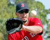 FORT MYERS, FL, Feb. 22, 2012: Boston Red Sox pitcher Josh Beckett catches the baseball while covering home plate during pitchers' fielding practice drills at Spring Training workouts. (Brita Meng Outzen/Boston Red Sox)