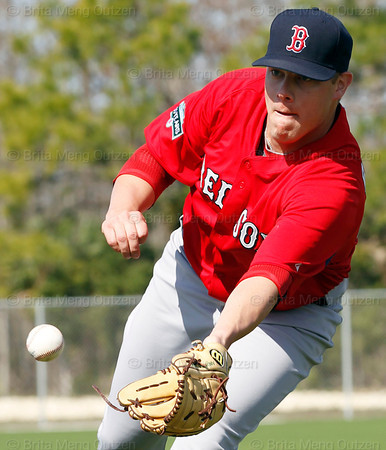 FORT MYERS, FL, Feb. 22, 2012: Boston Red Sox pitcher Andrew Bailey flips the baseball to the catcher covering home plate during pitchers' fielding practice drills at Spring Training workouts. (Brita Meng Outzen/Boston Red Sox)