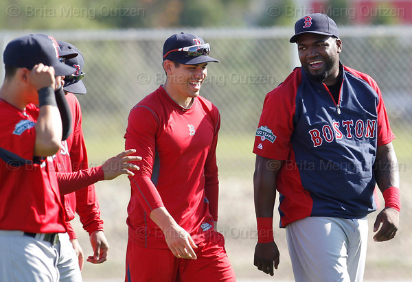 FORT MYERS, FL, Feb. 22, 2012: Boston Red Sox designated hitter David Ortiz, right, and center fielder Jacoby Ellsbury, second from right, share a laugh with teammates, from left, Jose Iglesias, Darnell McDonald and Carl Crawford before an informal workout at Spring Training. (Brita Meng Outzen/Boston Red Sox)