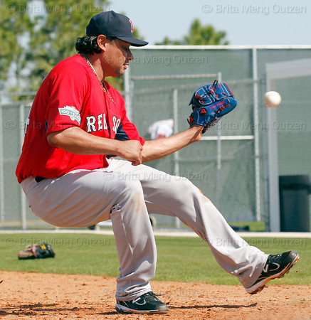 FORT MYERS, FL, Feb. 22, 2012: Boston Red Sox pitcher Vincente Padilla catches the baseball while covering home plate during pitchers' fielding practice drills at Spring Training workouts. (Brita Meng Outzen/Boston Red Sox)